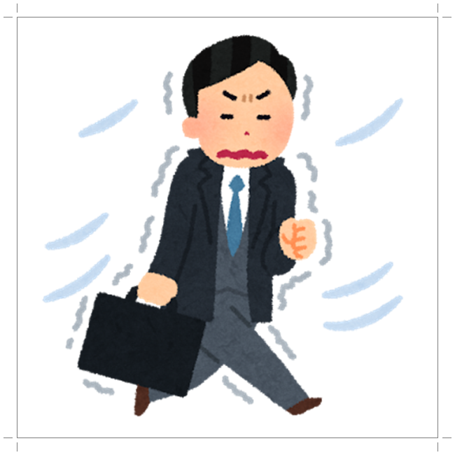 寒さに震えながら通勤するサラリーマン